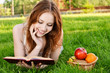 Girl with book and apples