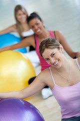 Women with pilates ball