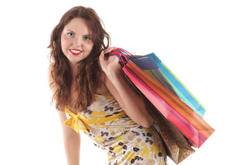 Smiling girl with shopping bags