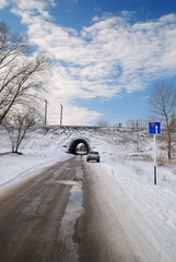 Winter landscape with a tunnel