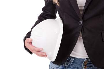 Business woman holding an helmet