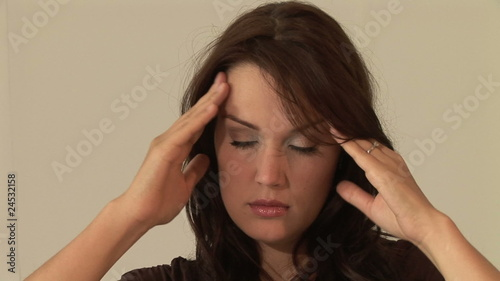 HD1080i Young woman having headache and massaging her head