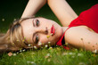pretty girl laying on a meadow
