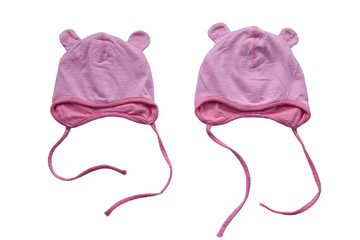 Pink baby hats isolated on white