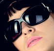 The stylish woman in sunglasses