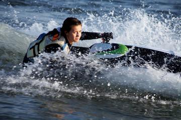.beautiful girl riding her jet skis.