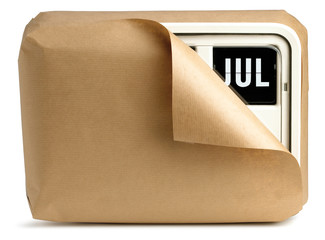July office clock calendar wrapped up in brown paper