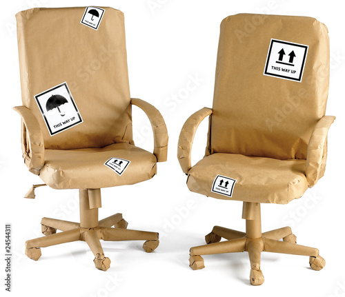 office chairs all wrapped up in brown paper for a move - 24544311