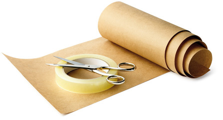 brown paper and sticky tape and scissors ready for wrapping up