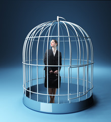businesswoman in a birdcage