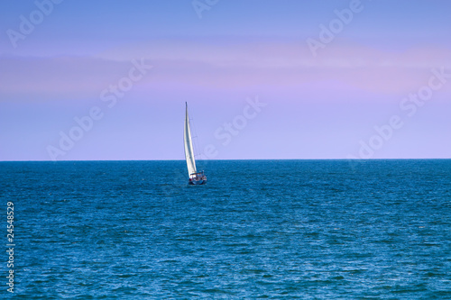 Sailboat On Ocean at Dusk