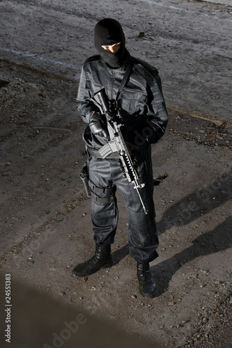 Soldier in black uniform with M-4 rifle