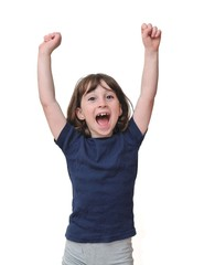 Cute little girl raises her hands in a victory sign