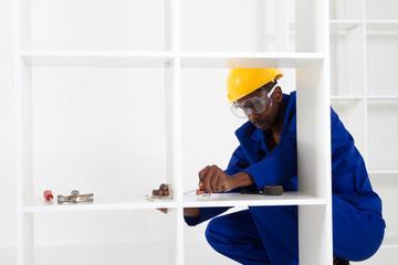 male carpenter making furniture