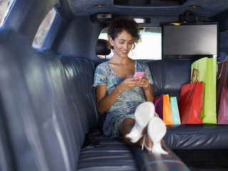 woman in limousine after shopping
