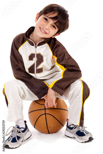 Cute kid sitting on the ball