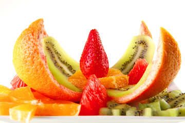 raw fruits on plate