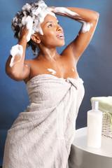 Cute African American using shampoo
