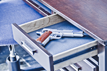 Handgun in desk drawer