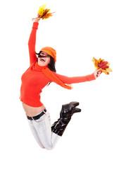 Girl in autumn orange sweater with leaf jump.