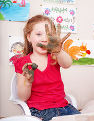 Child  playing with  clay in play room.