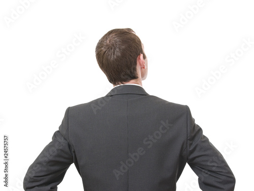back of pensive businessman looking up isolated on white