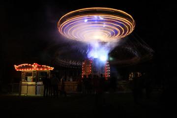 Spinning carousel at night