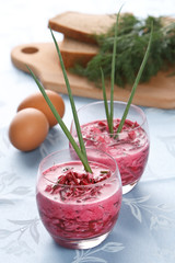 Red beet soup made from beetroot with vegetable salad