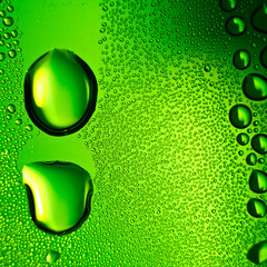 Green water drops background. Square composition.