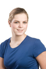 Headshot portrait of teenage girl in blue blouse