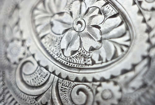Antique silver engraving background closeup.