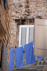 Old wall, window and blue linen (Italy)