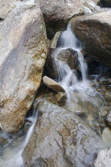 Water Pouring between the Rocks