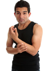 Man, fitness instructor, builder nursing sore arm