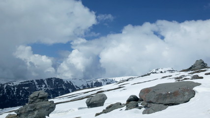 Blue sky time lapse on top of snowy mountain
