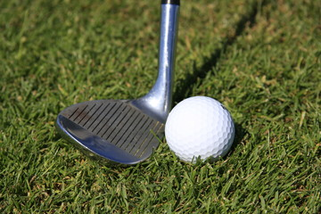 GOLF - closeup pitching wedge & golf ball