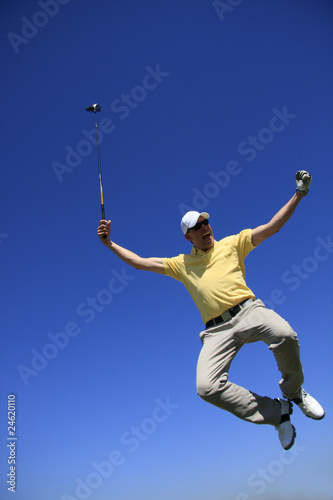 GOLF - jumping golfer with deep blue sky