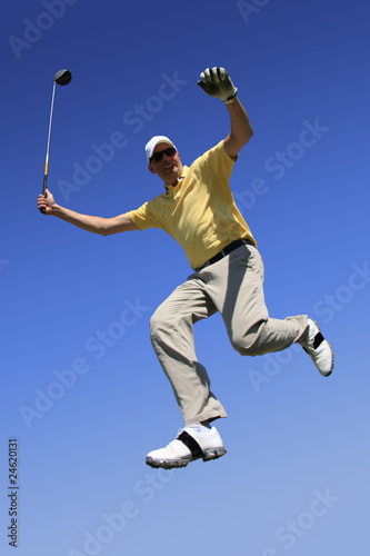 happy golfer jumping in the air
