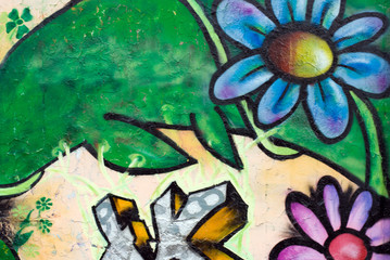 Flower on graffiti wall