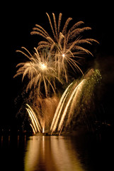 Gold fireworks on lake