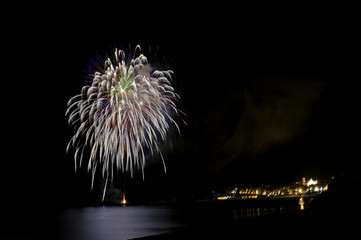 Fireworks on the pier with Marina di Camerota by night, Italy