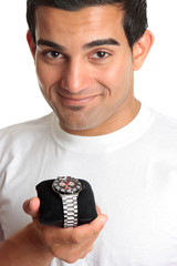 Man holding a chronograph wrist watch