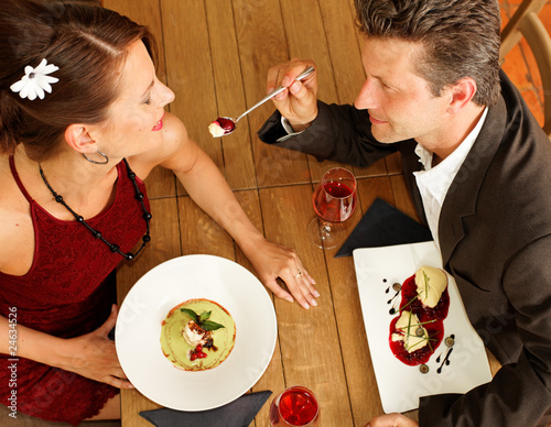 couple feeding each other - dessert - food