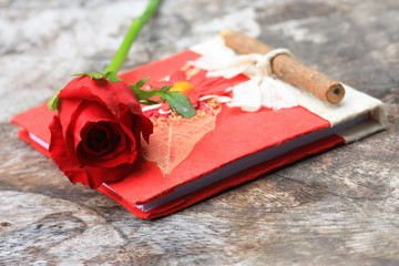 Red rose and Red diary.