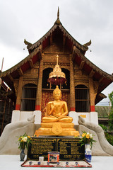 Buddha image in front of church