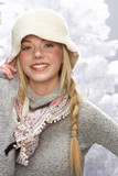 Fashionable Teenage Girl Wearing Cap And Knitwear In Studio In F poster