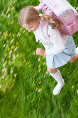Little girl rushing to school