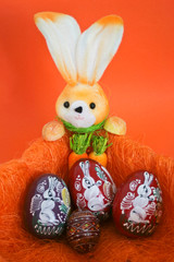 Easter Bunny with easter eggs in an orange composition