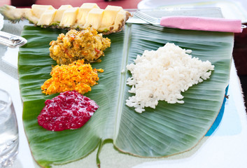 Traditional Indian meal serve on banana leaves, India