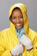 Young Woman Wearing Yellow Raincoat In Studio